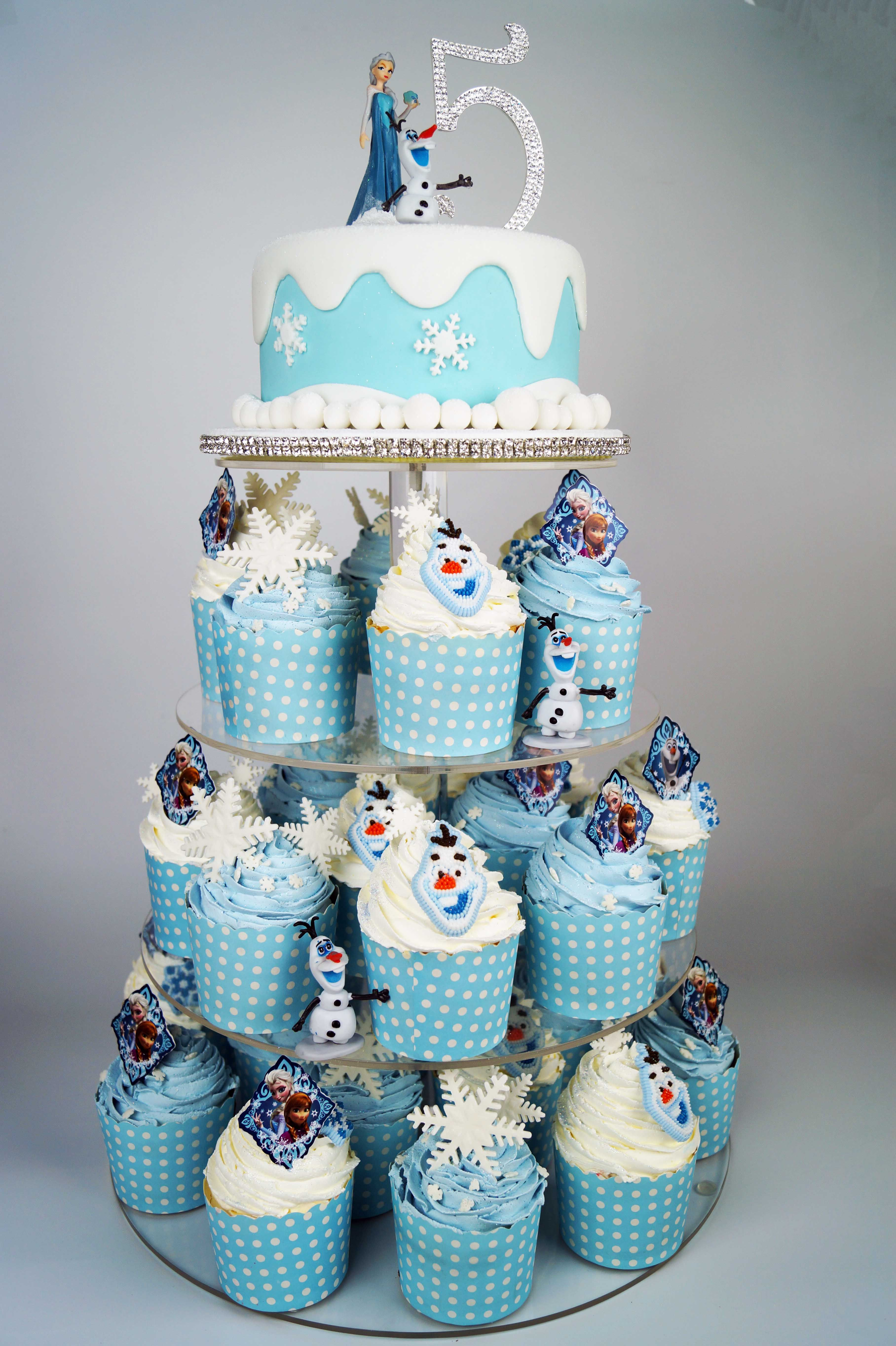 A Gorgeous Frozen Cake And Cupcake Tower Available At