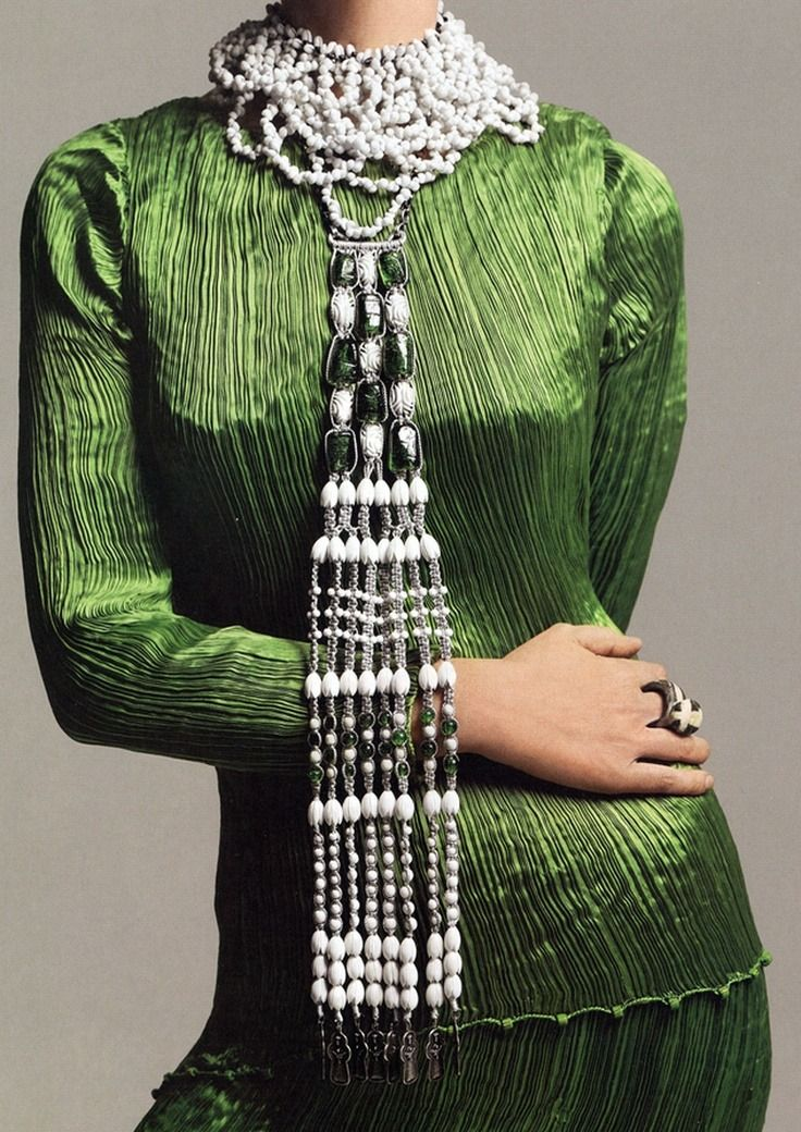 """""""  Gloria Vanderbilt modeling her Fortuny dress and Rita Delisi necklace. Photographed by Avedon for Vogue (US), December 1969. """""""