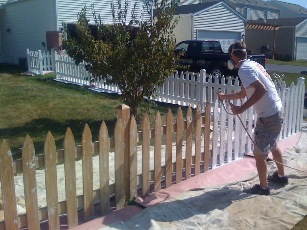 How long should i wait before staining my new wood fence