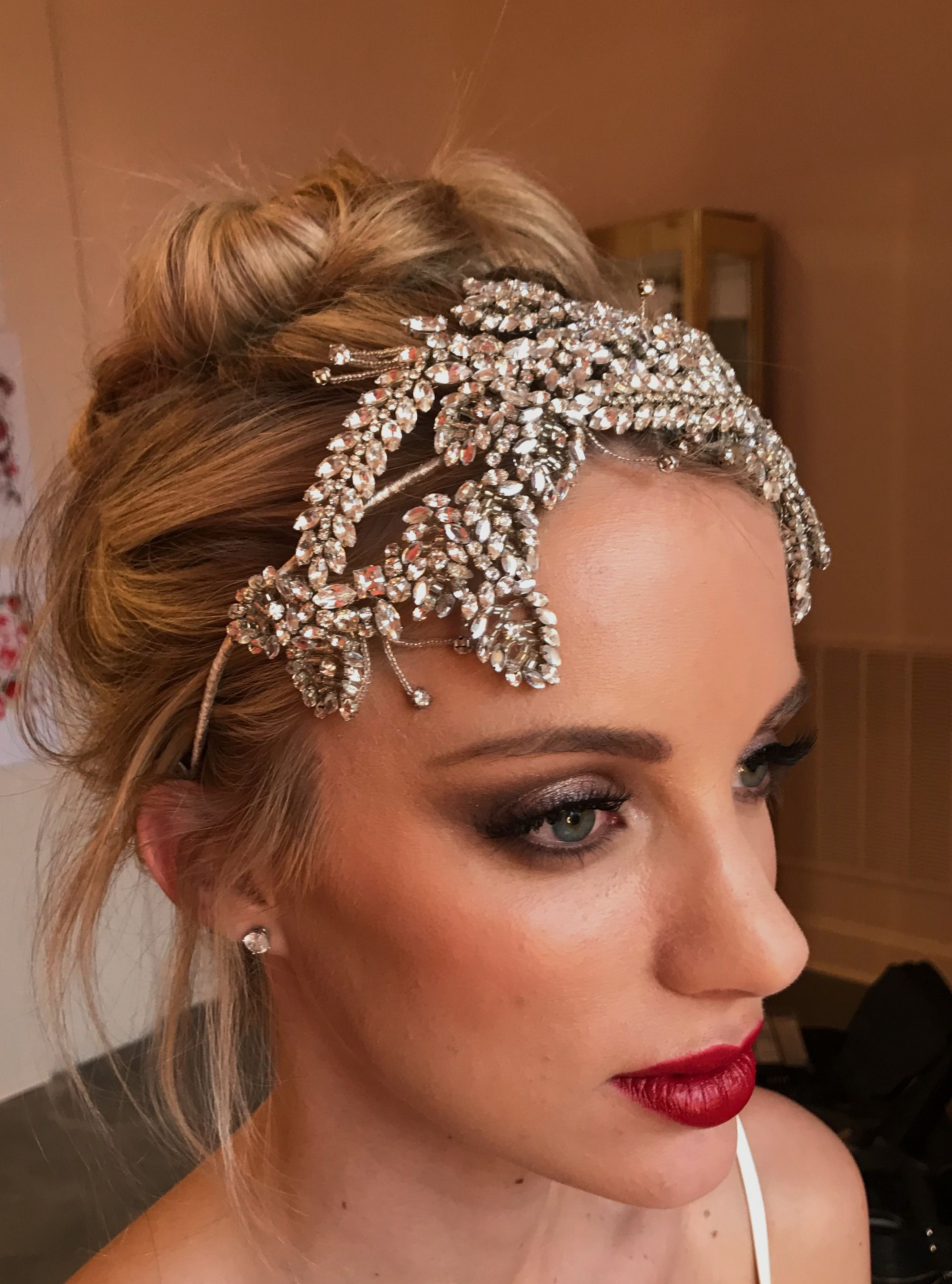Smokey eyes and a strong red lip, Own your bold bridal