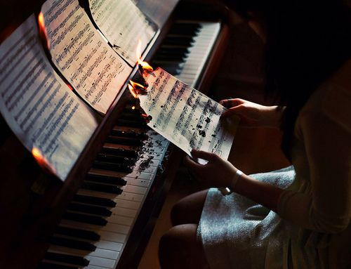 she sat at the piano and played, her fingers dancing slowly