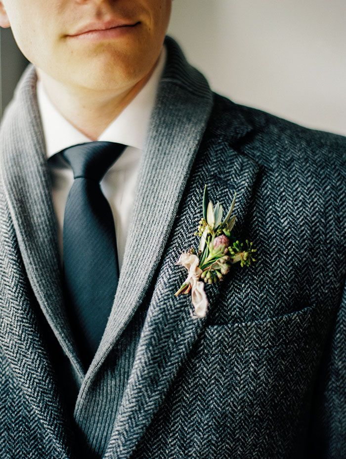 Gray and Black Textured Suit for a Winter Groom | Michele Hart Photography | http://heyweddinglady.com/mid-century-minimalist-winter-wedding-styling/