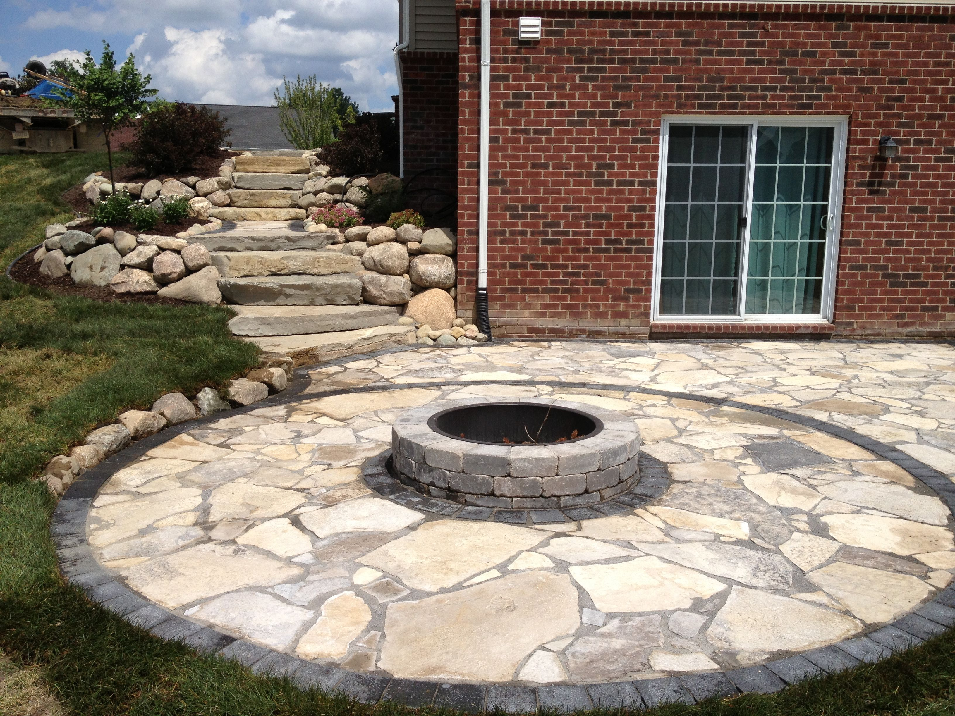 Canadian Flagstone Patio With Brick Paver Accent Brick And Unilock Fire Pit All Natural Landscapes Flagstone Patio Patio Landscaping Fire Pit Backyard