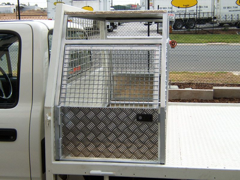 dog boxes Ute Dog Cage. I would put several of these on
