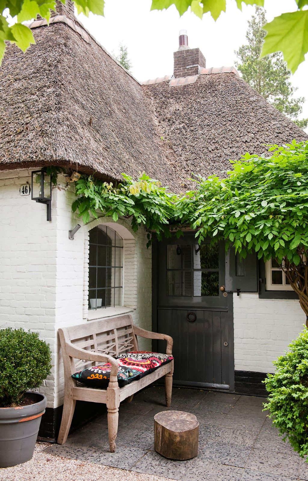 bench outside and thatched roof