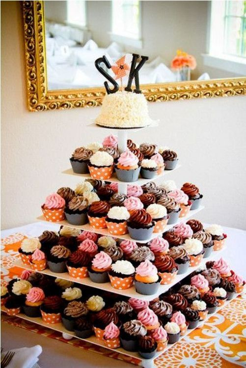 colorful wedding cake from cupcakes with letter topper