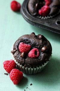 Moist chocolate muffins stuffed with juicy red raspberries!