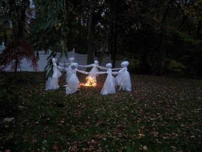 diy lawn ghosts using plastic drop cloths and newspaper