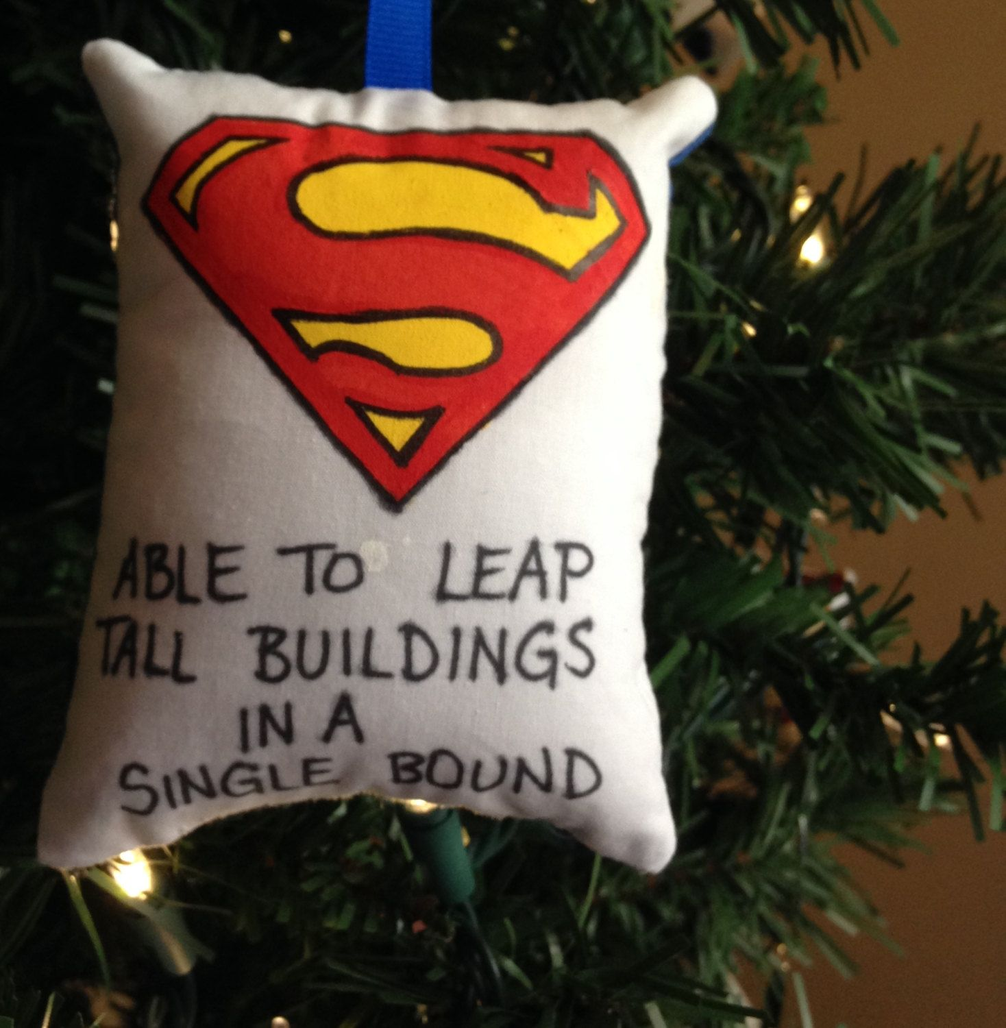 Superman Symbol Logo Able To Leap Tall Buildings In A Single
