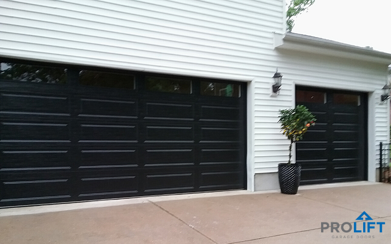 Black Garage Doors With Long Windows In 2020 Garage Door Colors Garage Door Design Modern Garage Doors