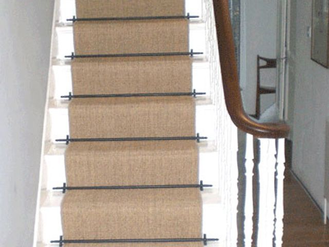 Sisal Carpet Laid As Runner With Stair Rods