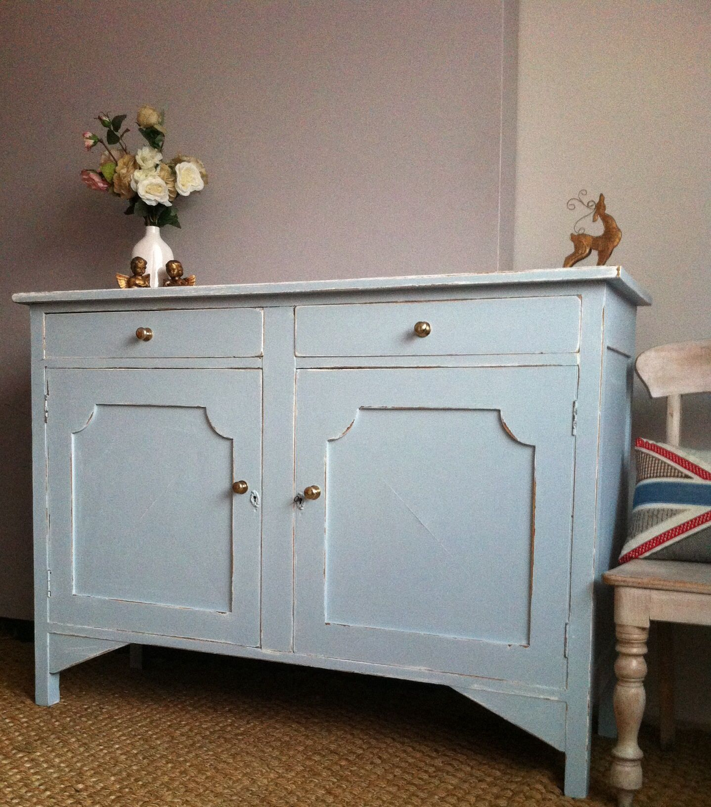 Beautiful shabby chic buffet sideboard in duck egg blue, detailed with gold colored victorian handles . The perfect distressed statement piece to show on display, with two pullout drawers, two lockable open door cupboards, with single shelved storage . A large solid piece with multiple options for your home. Buyer will not be disappointed   Approximate Dimensions - 138cm W x 100cmH x 48cm D
