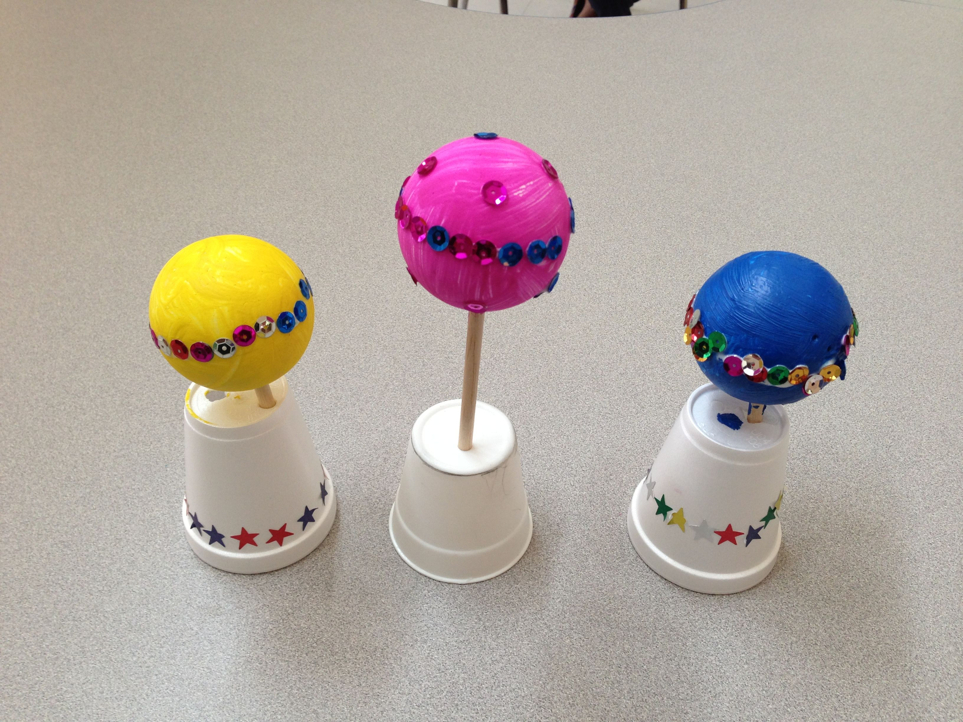 Outer Space theme craft, planets made from styrofoam balls and candy apple  wooden sticks paint