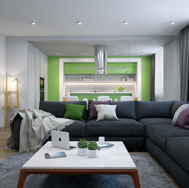 Open space cucina soggiorno con un divano angolare di colore grigio ...