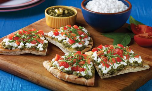 Get lots of flavor without lots of calories in this yummy appetizer from Daisy Brand: Pizza Pita Snackers.