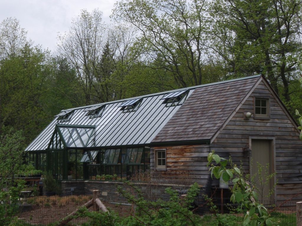 Awesome English greenhouse on a stone base with barn shed