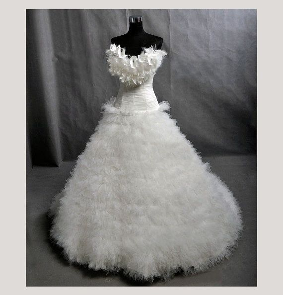 Exquisitely finished feather trimmed skirt by CrystalBridalNYC, $1699.00