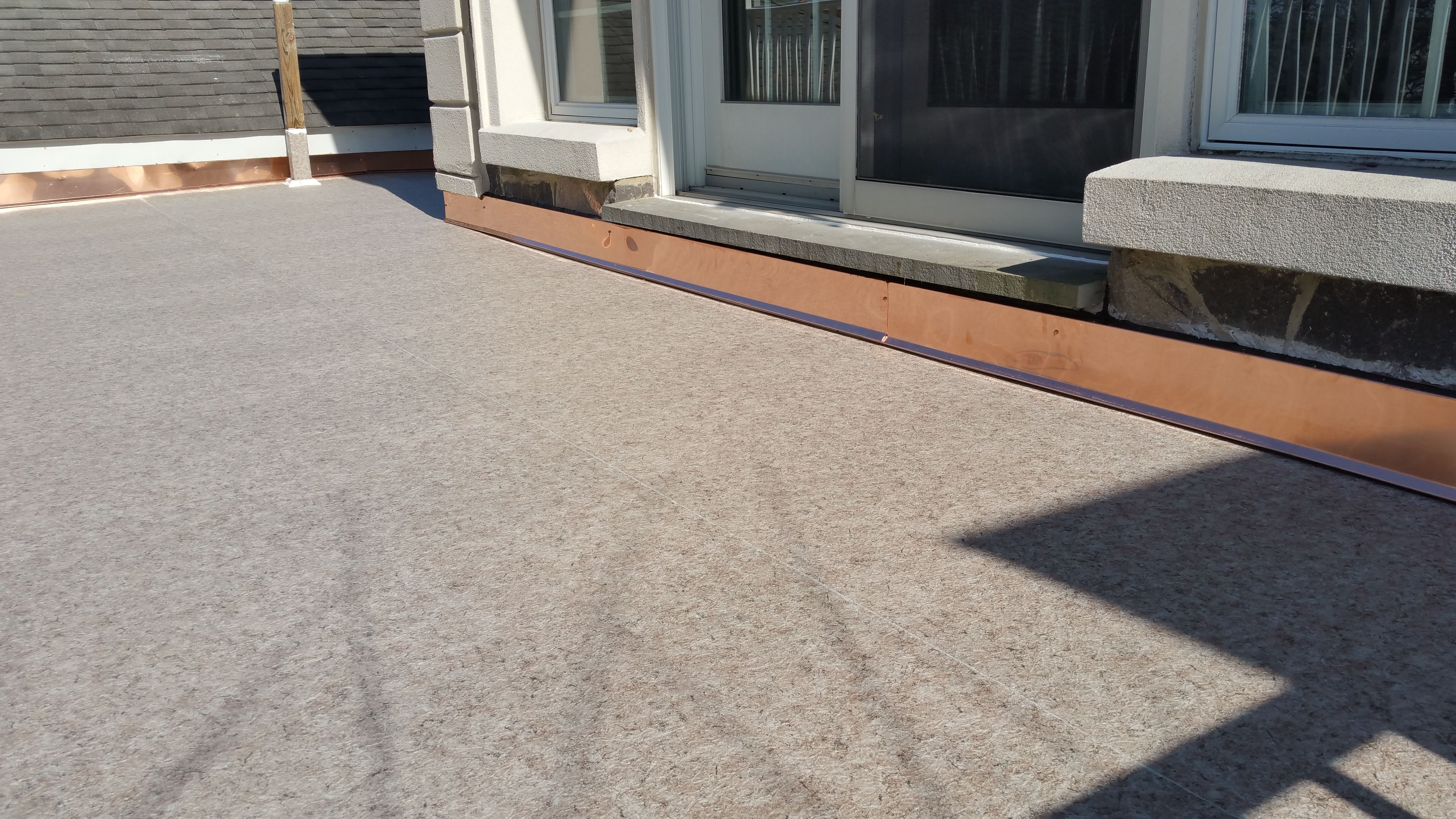 Duradek Ultra Sienna outdoor vinyl flooring provides a