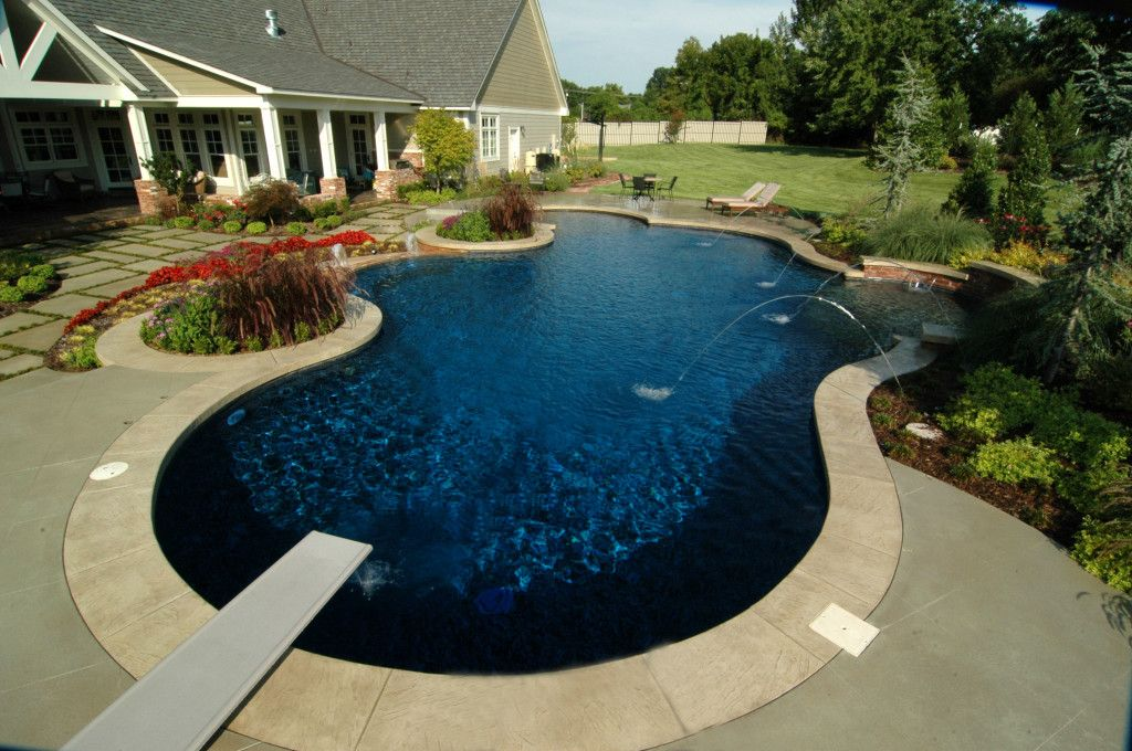 Deep Backyard Pool with a diving board, deep and shallow zones and deck jets, this