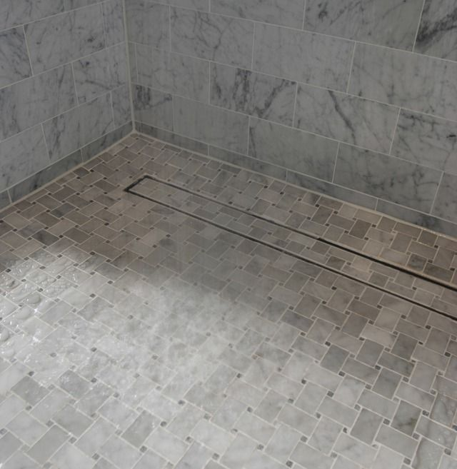 Fresh Tile Around Basement Floor Drain