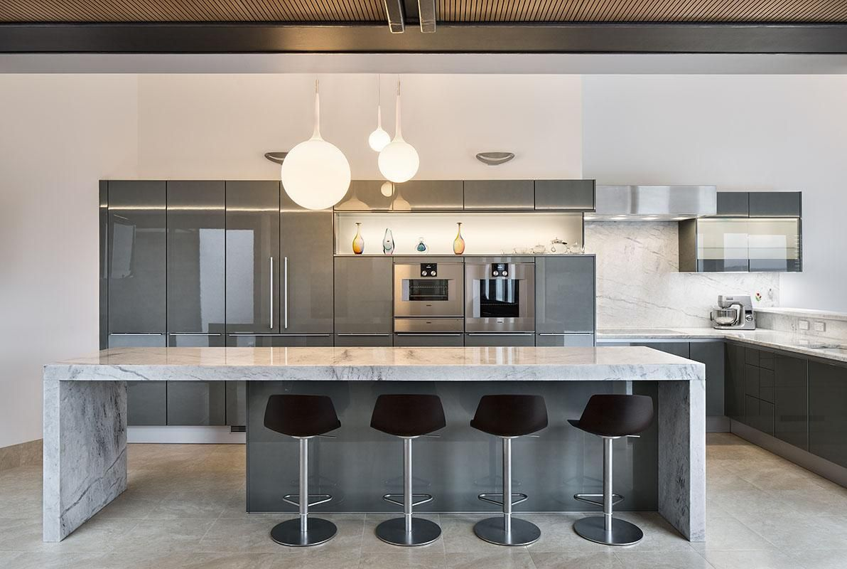 gunmetal gray along with carrera marble make this modern kitchen