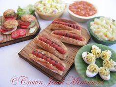 Would you like ketchup or mustard with that?  Realistic 1:12 scale hot dogs by Crown Jewel Miniatures.