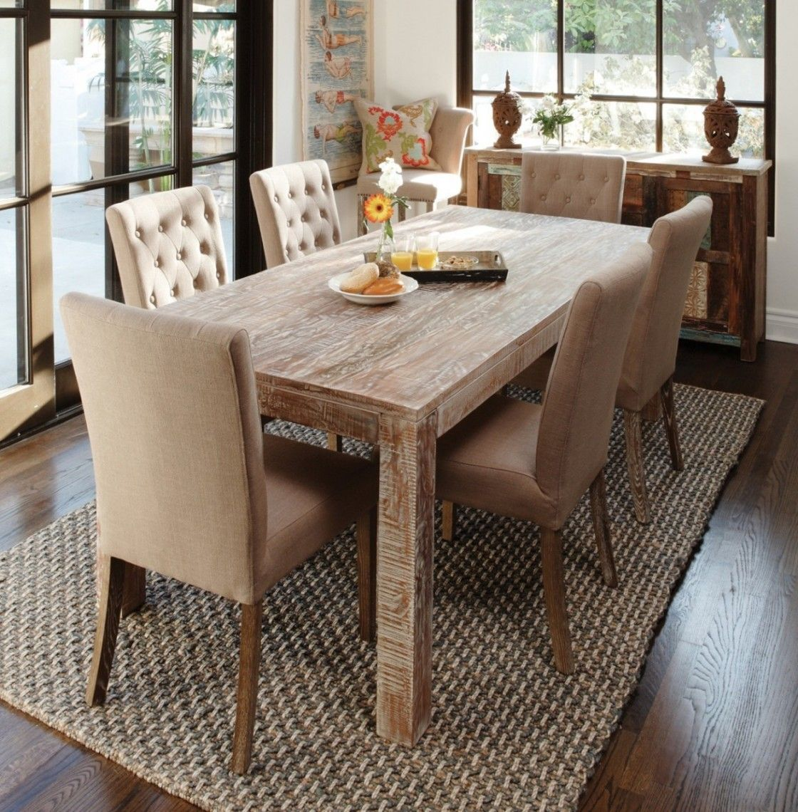 Adorable reclaimed pine wood dining table with six linen upholstered dining chair sets has an tufted backrest and square solid wood legs on are grey woven