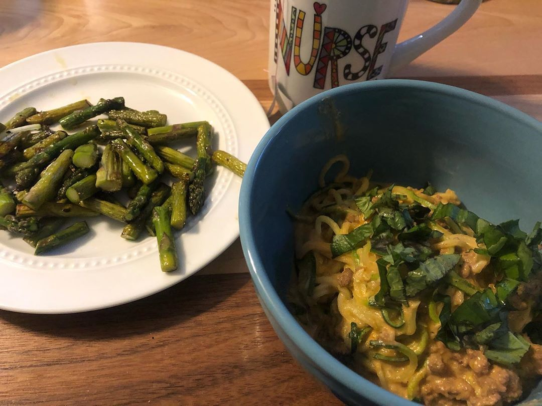 Roasted red pepper zoodles and beef from The Whole Smiths' book with asparagus cooked in ghee and te...