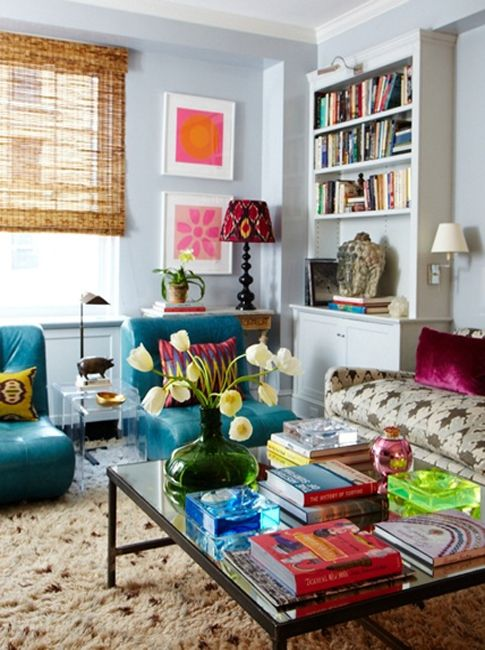 Rita Konig living room with bengal bazaar upholstered sofa, fluffy rug turquoise chairs and pops of neon