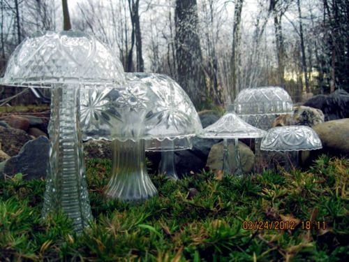 Crystal mushrooms made from bowls and vases.