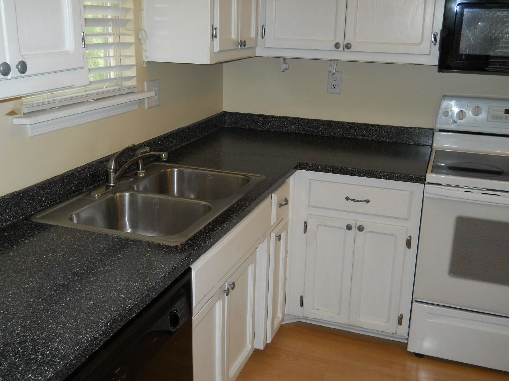 Laminate countertops with white cabinets countertops and white top cabinet also laminate - White kitchen dark counters ...