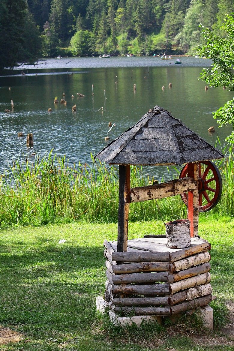 Wishing well lawn ornament - Old Wishing Well On The Lake Or In The Back Yard