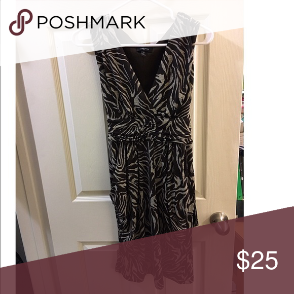 Animal print dress! Ridiculously comfortable dress with pockets. Ties in the back and slips over your head. Only worn a couple times-in perfect condition. Iz Byer Dresses Midi