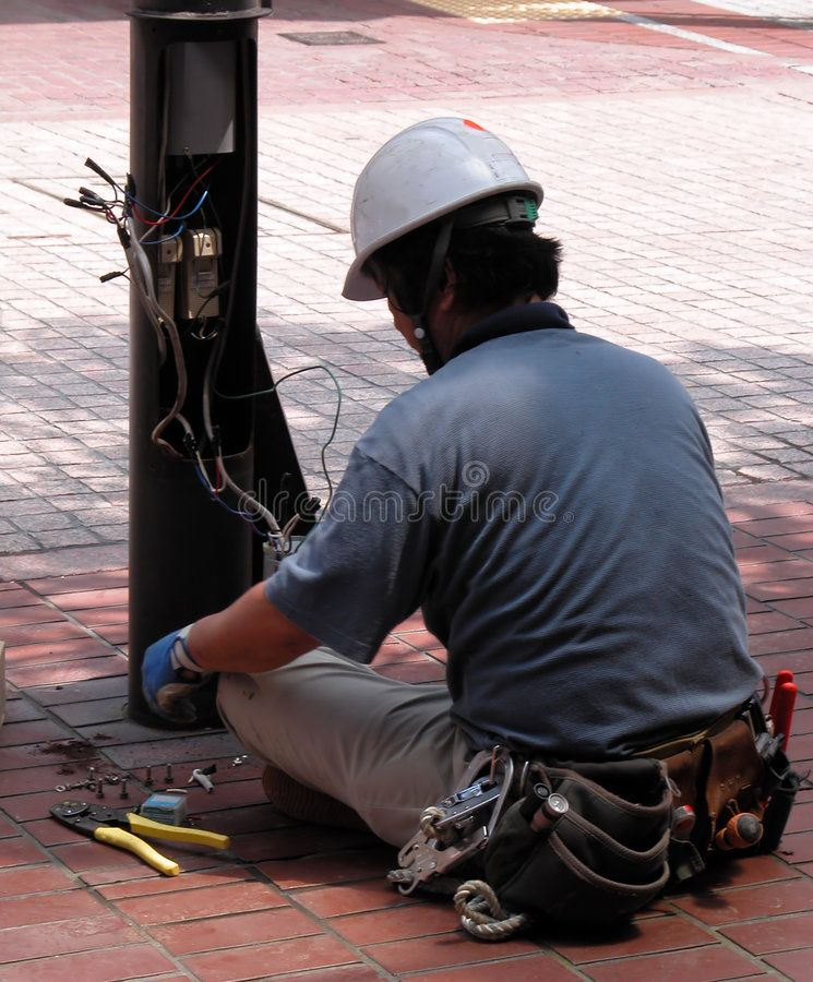 Electrician doing his job in the street sponsored