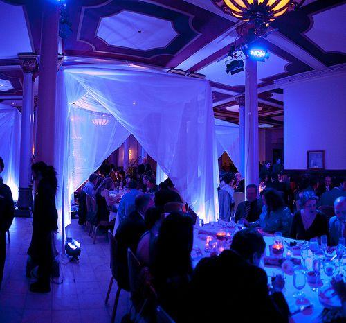 blue lighting drapery lighting event room centerpieces and weddings