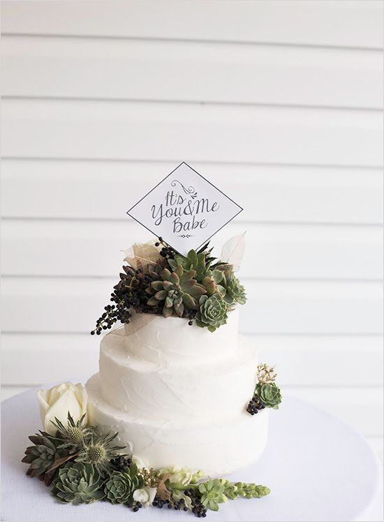 Lovely white cake with greenery and topper captured by Ivory and Olive Photography and Design. #wchappyhour #weddingchicks http://www.weddingchicks.com/2014/09/29/ivory-and-olive/