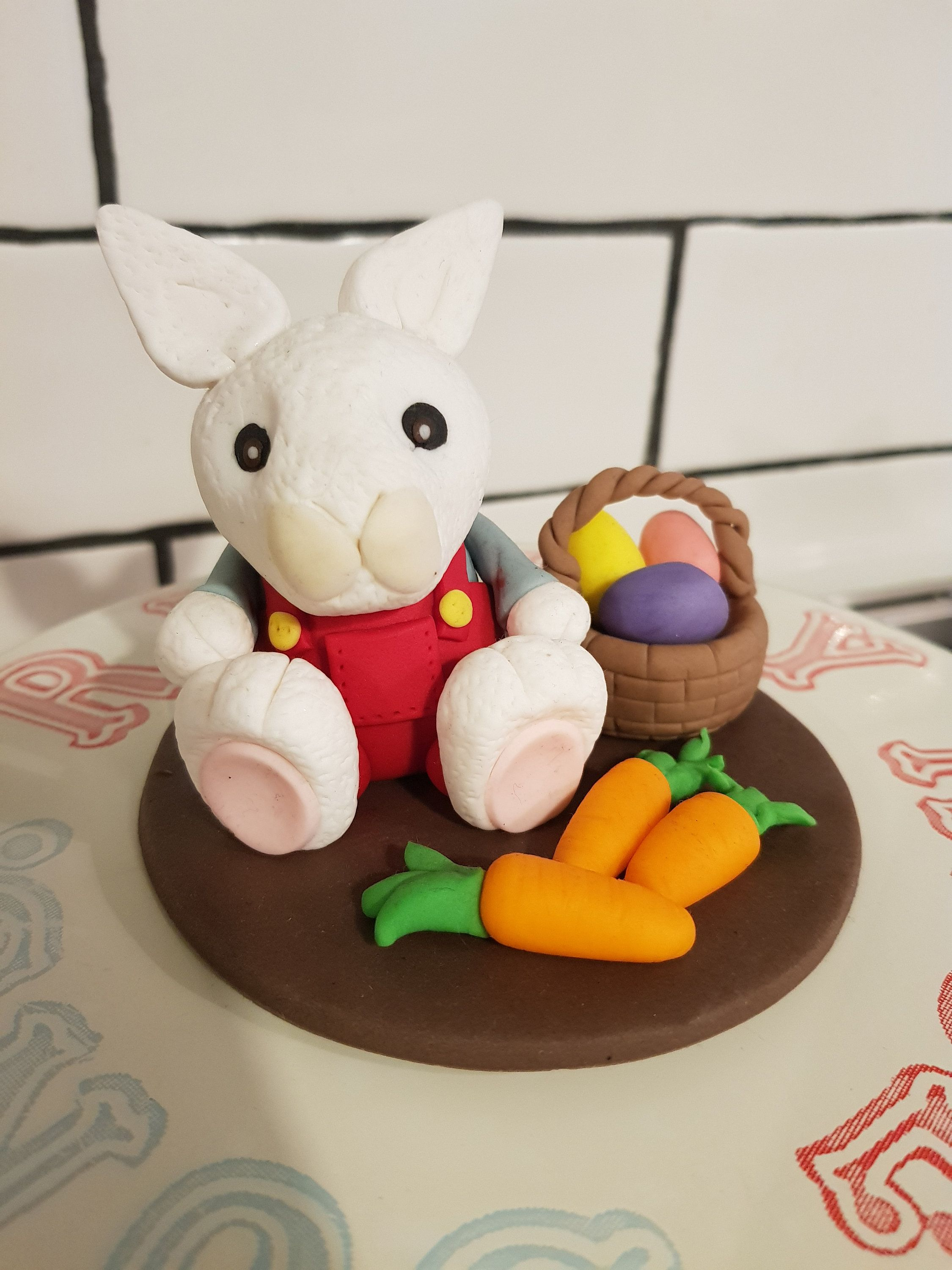 Bunny in red overalls with carrots and a basket fondant