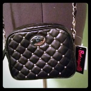 I just discovered this while shopping on Poshmark: Betsey Johnson black cross body! . Check it out!  Size: OS