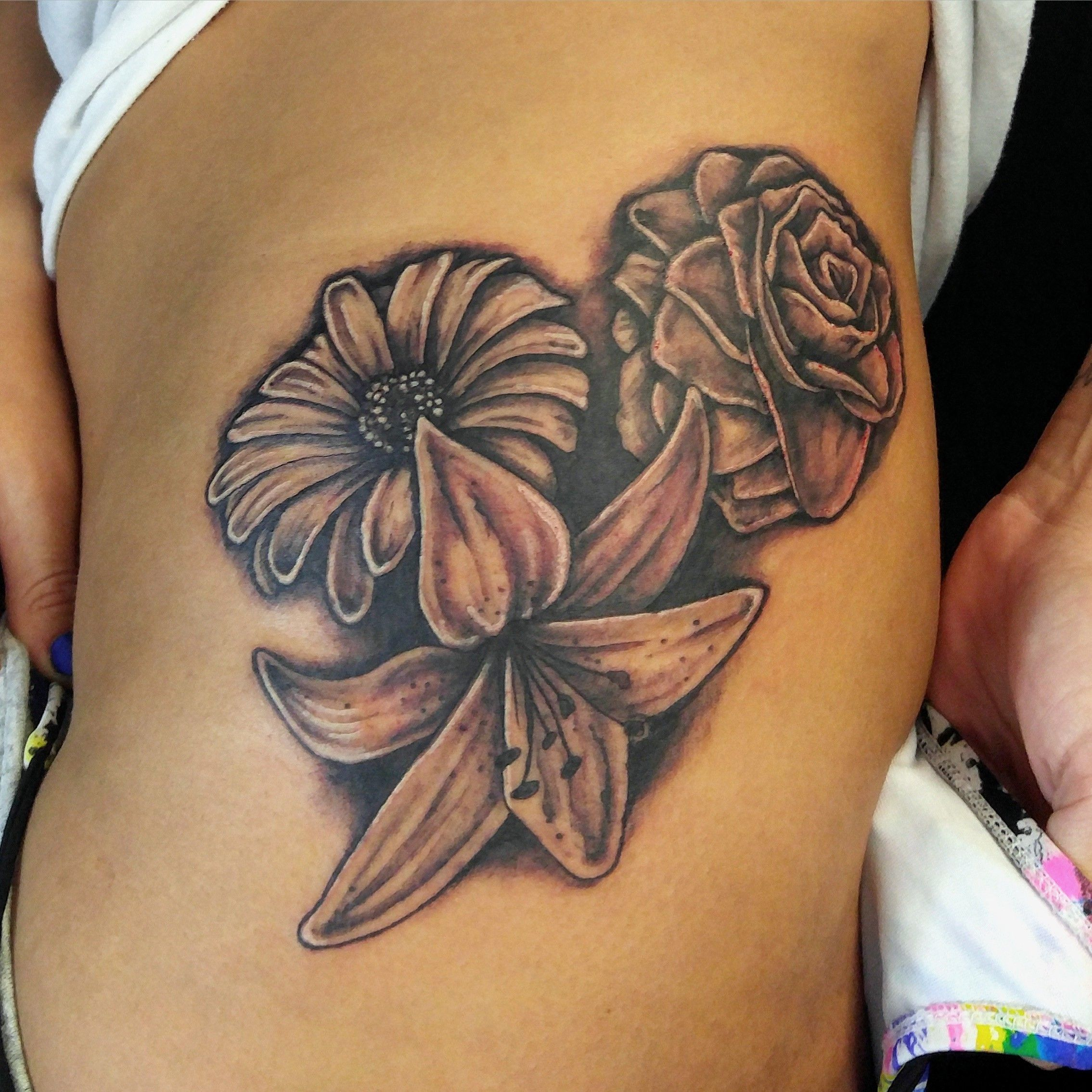 rose lily daisy tattoo by mike hessinger at moonlight tattoo seaville nj moonlight tattoos. Black Bedroom Furniture Sets. Home Design Ideas