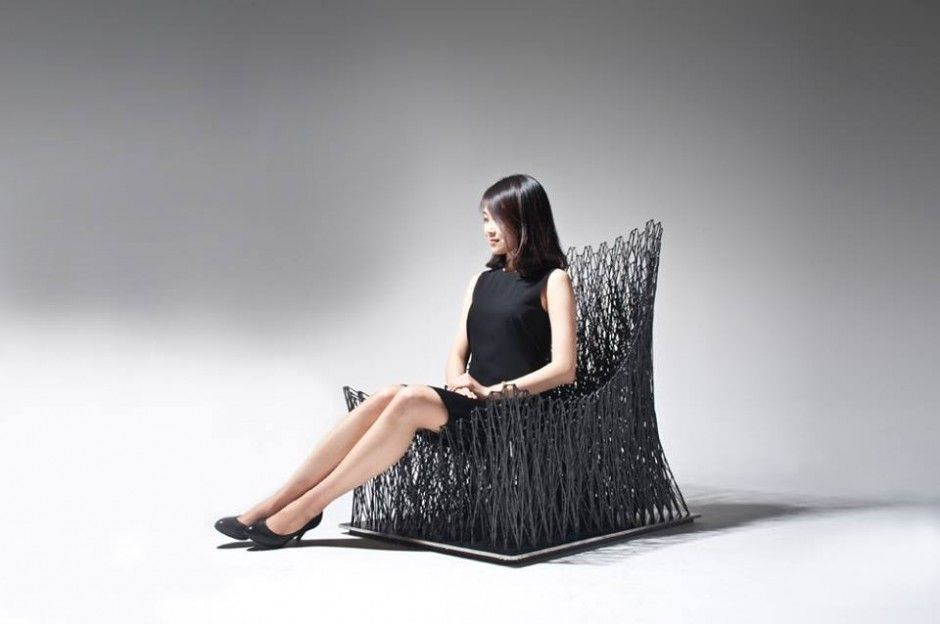 Design Studio IL HOON ROH have created a limited edition armchair, made from carbon fibre string woven together by hand.