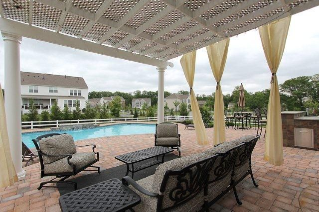 Enjoy a swim or sit under the pergola of this beautiful home in Leesburg Virginia managed by McGrath Real Estate
