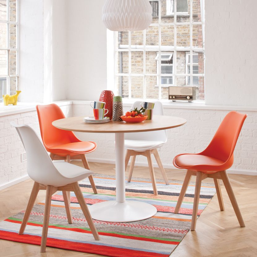 Jazz Up A Small Dining Space With Orange Jerry Chairs And