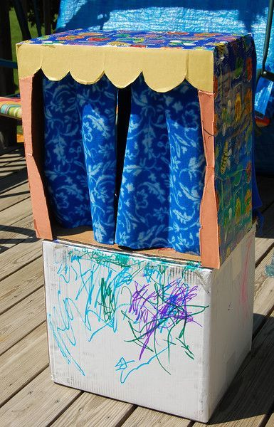 Cardboard puppet show stage. Site has lots of other ideas to make from a cardboard box, too! Fun! (and thrifty!)