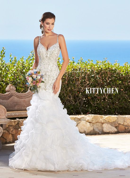 bf4642a85dba Beaded mermaid gown with organza ruffled bottom. Don't forget the low back!