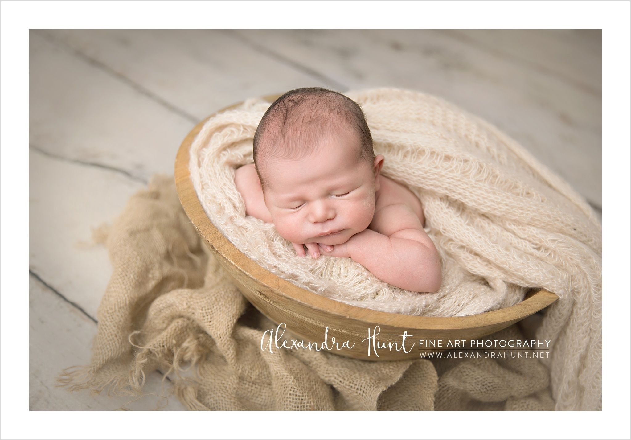Newborn in wood bowl best vancouver newborn photographer alexandra hunt photography follow us on instagram alexandrahuntphotography