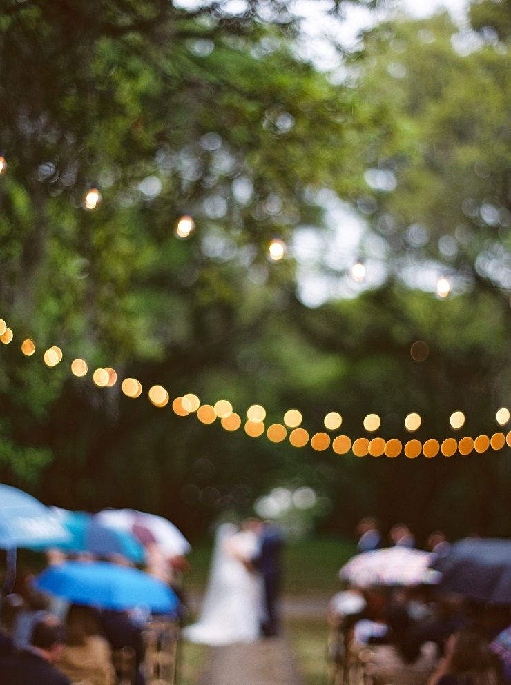 Love the bristo lights hung across the Wedding ceremony | fabmood.com