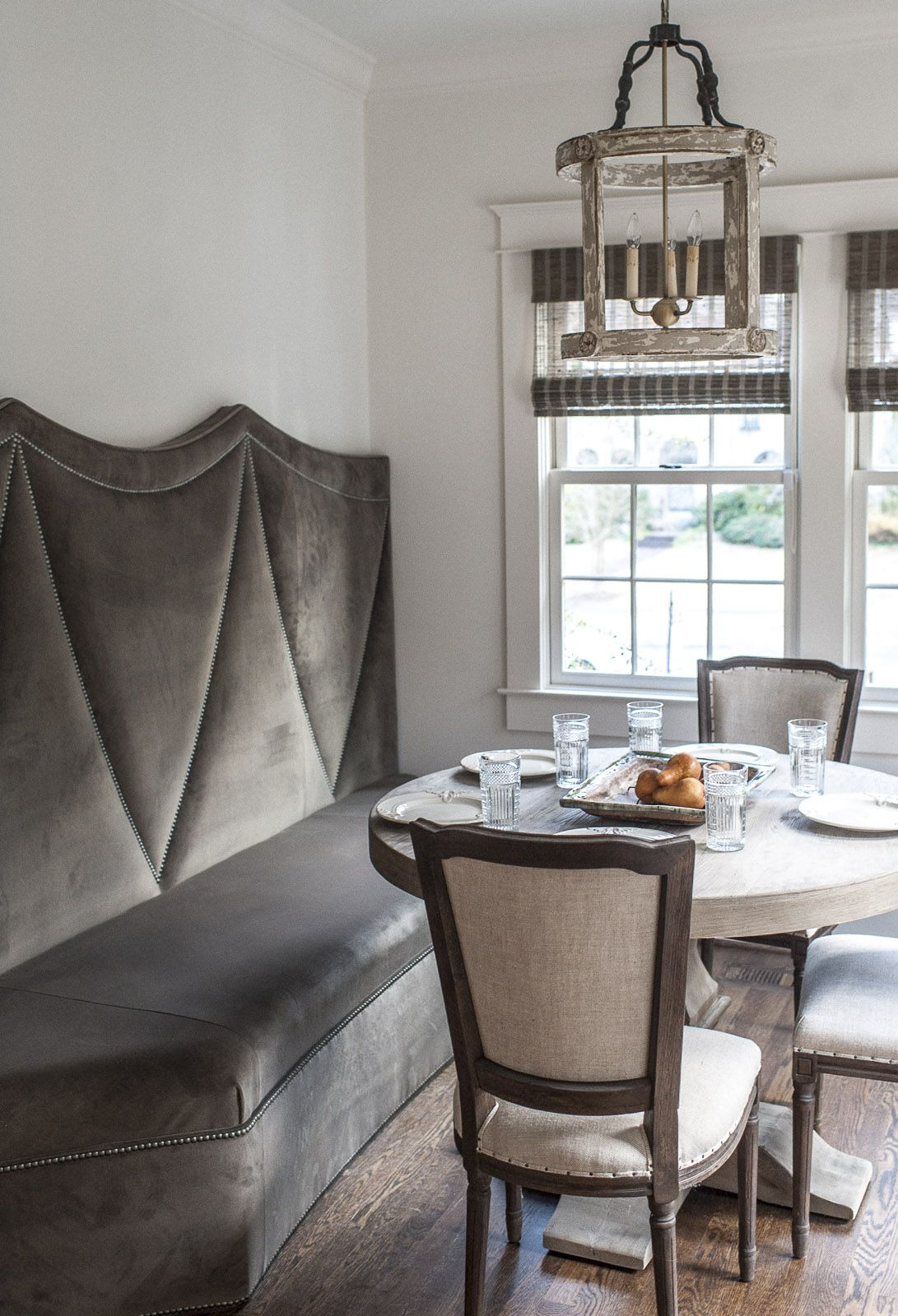 Stunning Breakfast Room Features A Curved Gray Velvet Banquette With Silver Nailhead Trim Facing Reclaimed Wood Dining Table Lined French