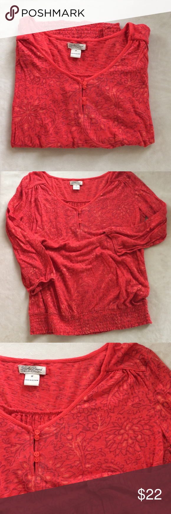"Lucky Brand top Cute top in dark coral with floral design.  Soft cotton/modal blend.  Soft and comfortable. Great condition.  No snags, holes Etc.  20"" across underarms.  24"" from shoulder to hem.  3/4 sleeve. Lucky Brand Tops"