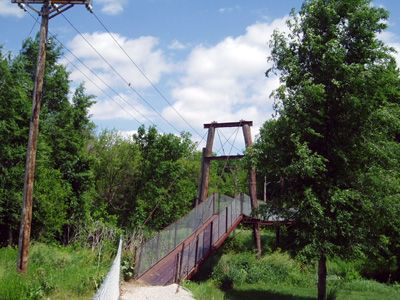 This is the swinging bridge that I used to cross the creek going to school