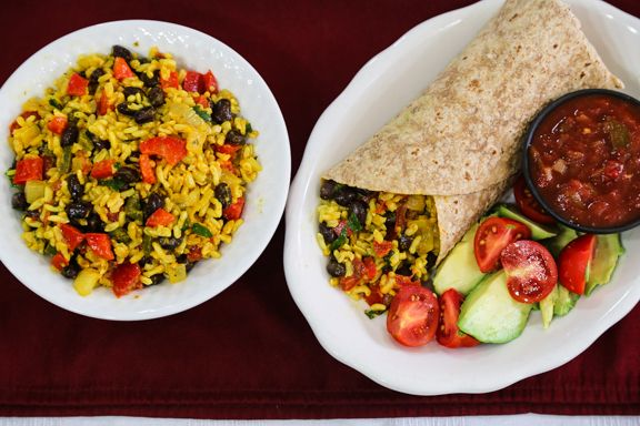 The combination of rice and beans wrapped inside tortillas is quite satisfying. These yellow rice and black bean burritos make a filling meal.